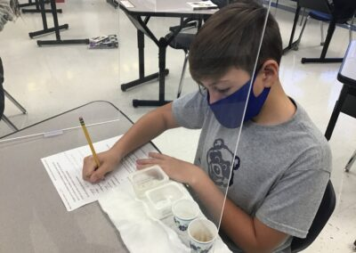 Middle school boy working on science experiment